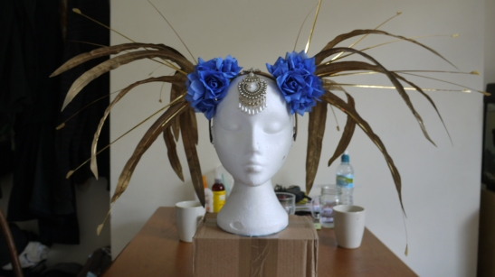 Let the wild world flow through you with a headdress constructed out of feathers and flowers. (c) Ally Katte
