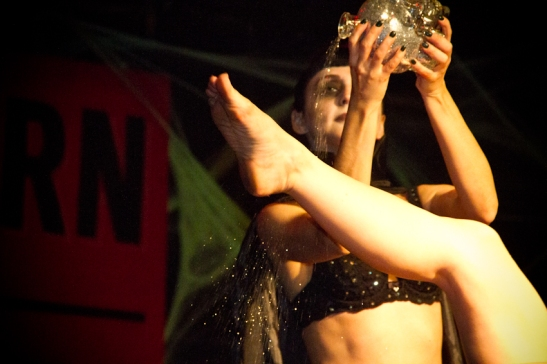 Roxie Le Rouge baptizes Kitty Twist with glitter at a Slow Burn Burlesque Show (c) Jian Bastille